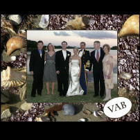 bride and groom at virginia beach with guests.