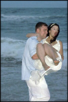 Bride and groom trah the wedding dress in the water off Virginia beach 23452